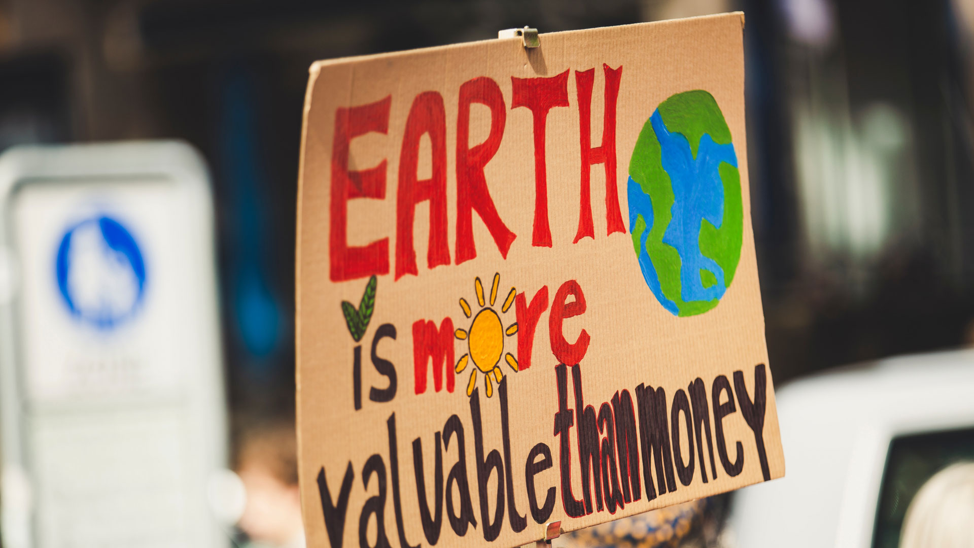 "Sign saying ""Earth is more valuable than money"""