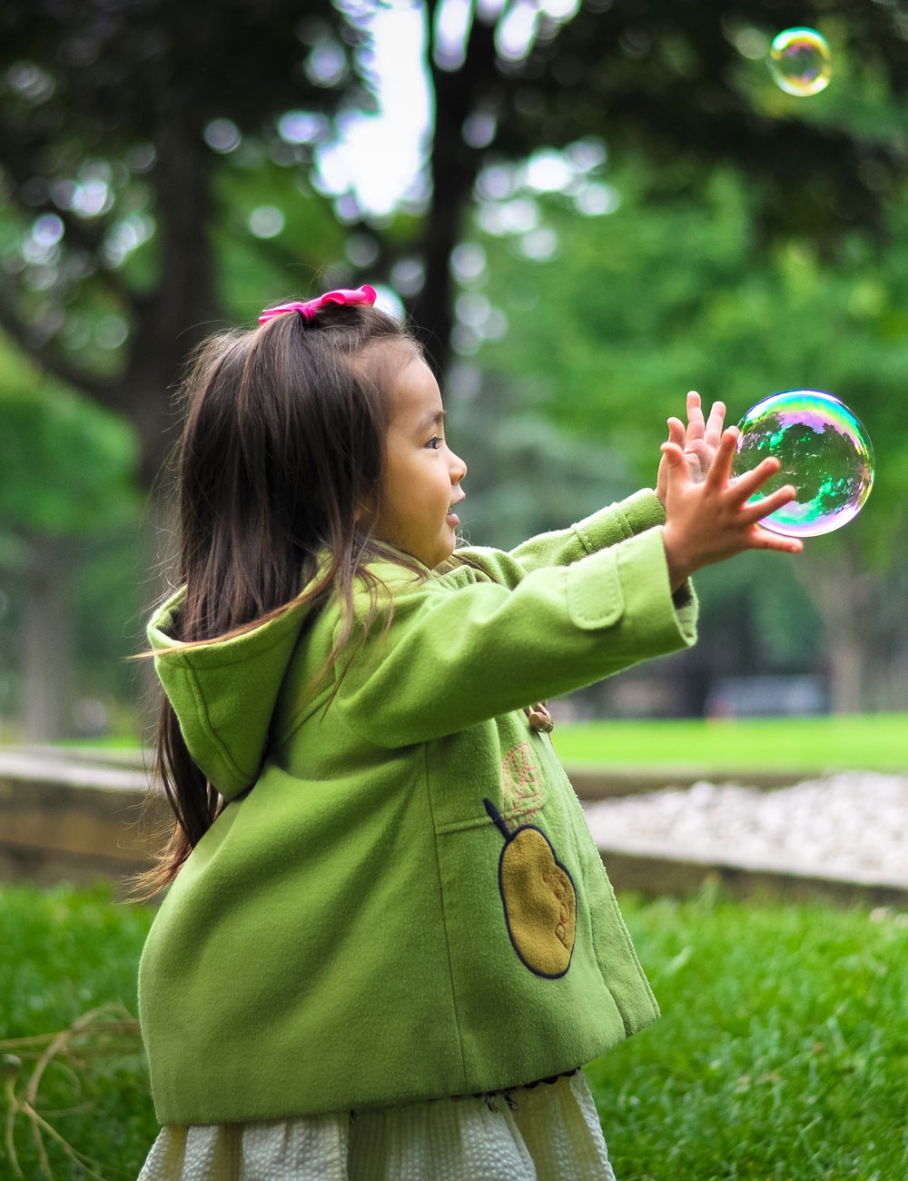 Child playing with bubblese