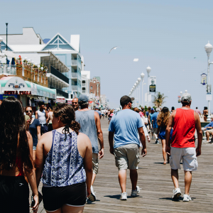 Tourists walking down the boardwalk in Ocean City, MD