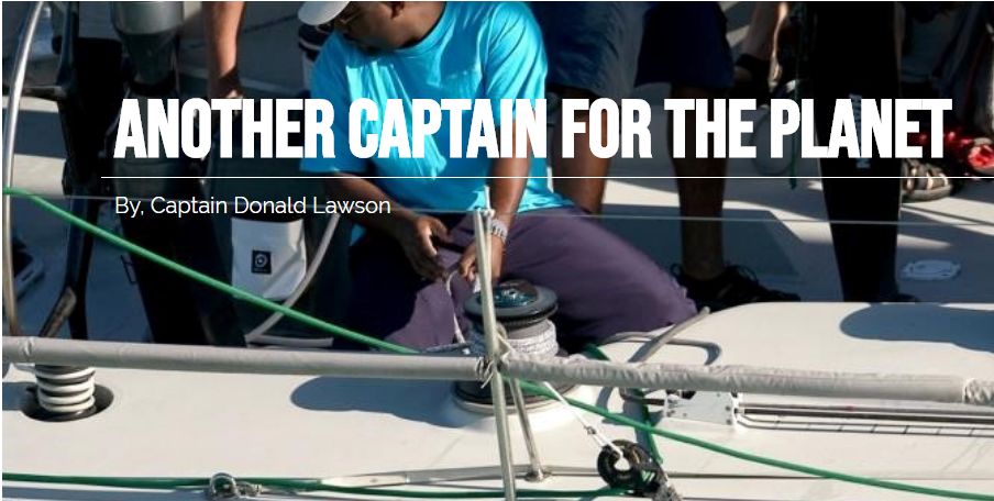 "Picture of Captain Lawson on a sailboat with ""Another captain for the planet"" written across the image"